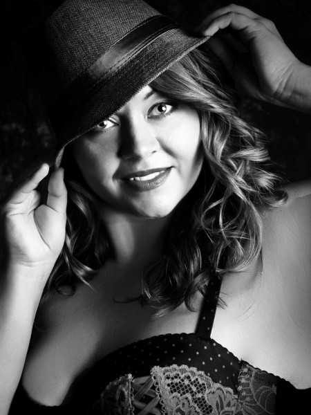 Glamour Shots Boudoir picture of woman wearing hat and lace