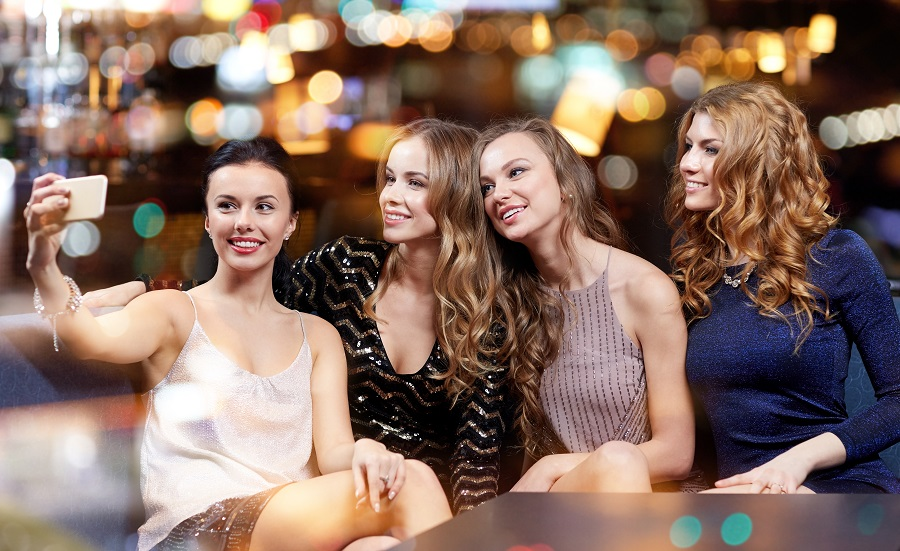 group of girls taking a selfie at a nightclub